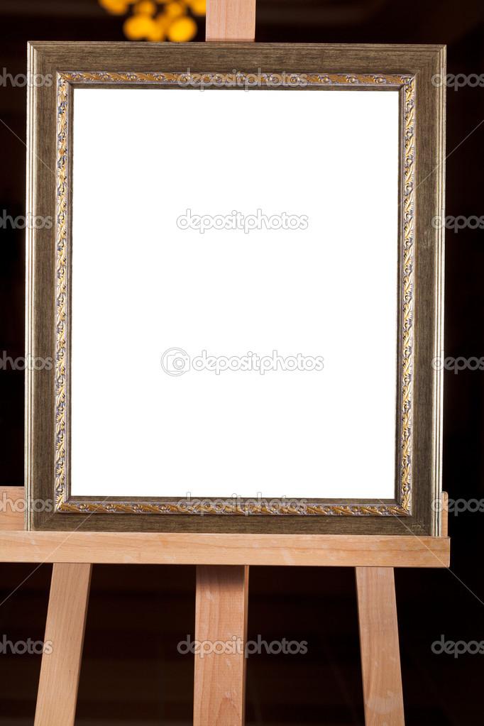alte Bilderrahmen mit weißen Leinwand auf Staffelei ausgeschnitten ...