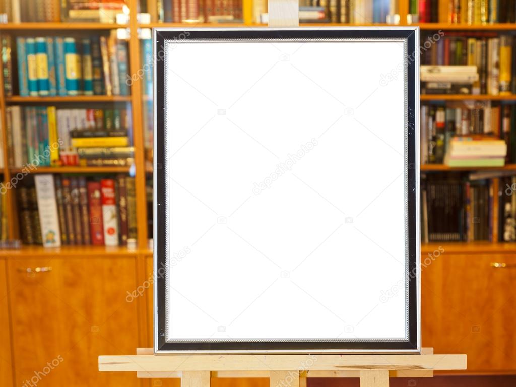 White canvas of picture frame on easel in library — Stock Photo ...
