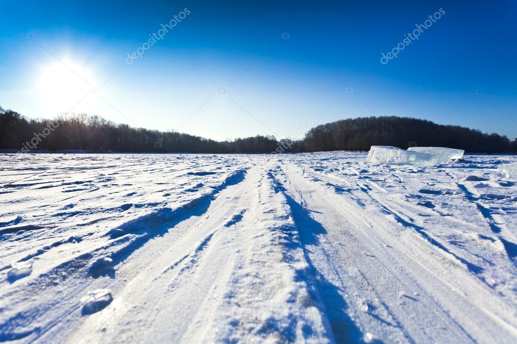 Ski track at snow field in cold winter day