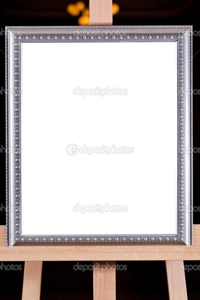 Silber Bilderrahmen auf Staffelei — Stockfoto © vvoennyy #18332093
