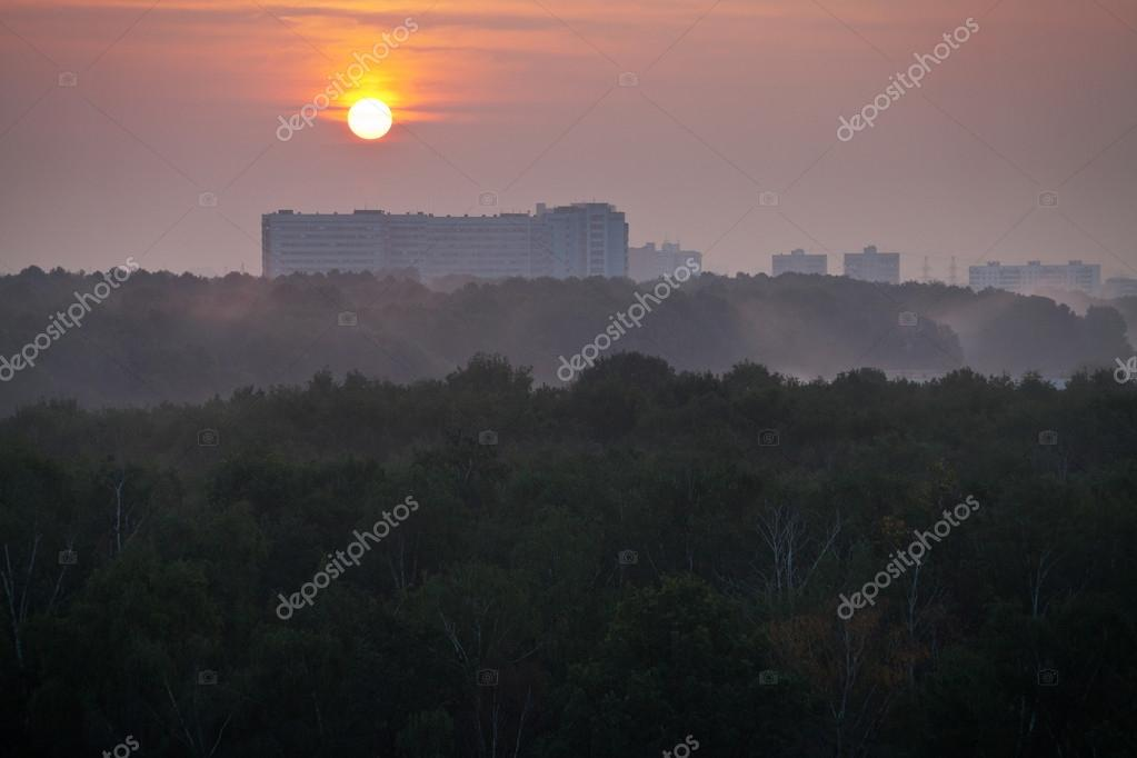 panorama of red sunrise over city