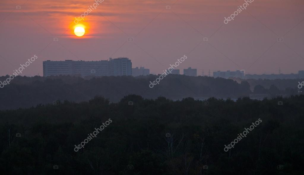 panoramic view ofred sunrise over city