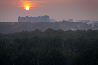 view of red sunrise over city