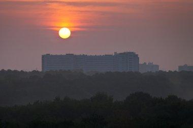 red daybreak over city