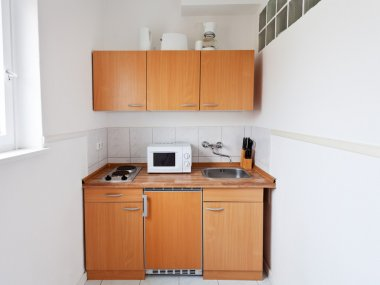 Small kitchen with furniture set