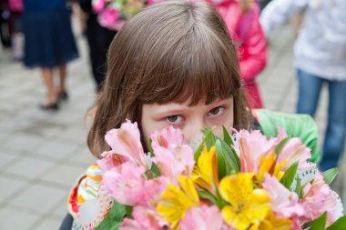 Schoolgirl with bouquet of flowers