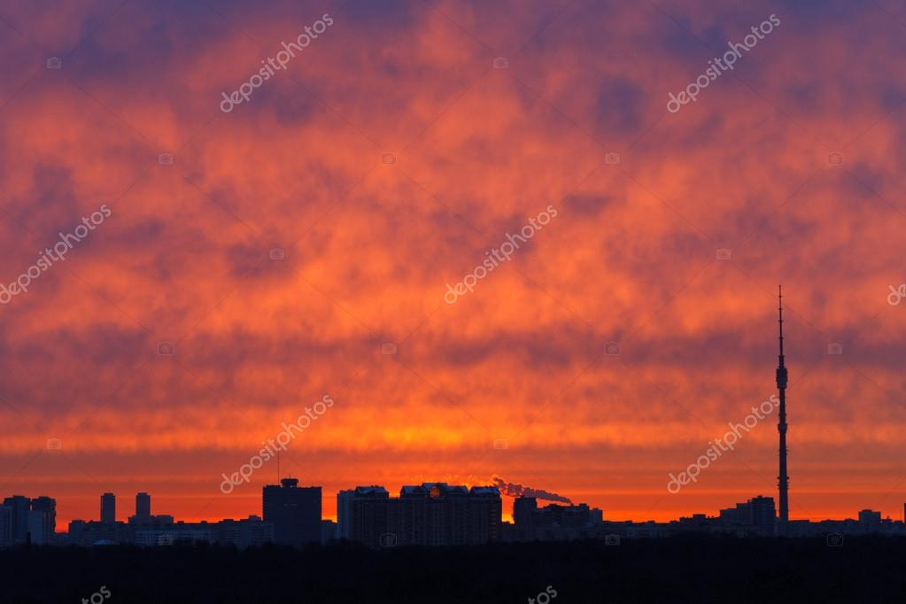 red clouds over city in spring