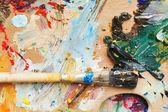 Photo paint brush on wooden artistic pallette