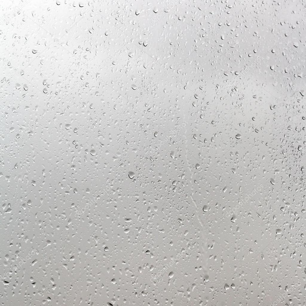 rain drops on window pane in cloudy day