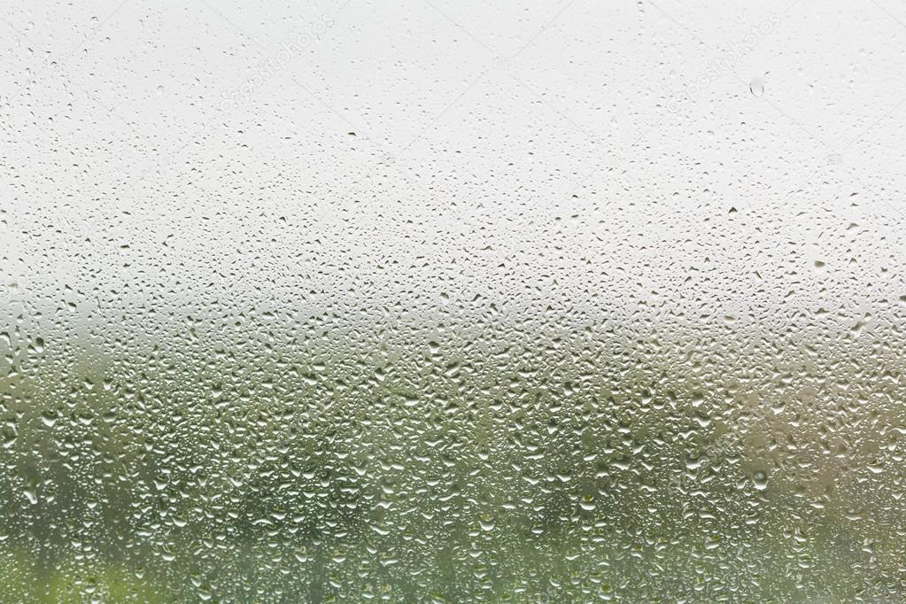 raindrops on home window glass