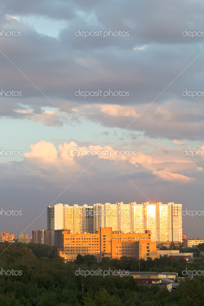 urban building lit by sunset light in summer