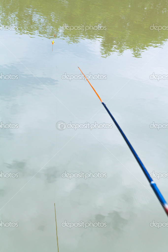 float floating in the calm river while fishing