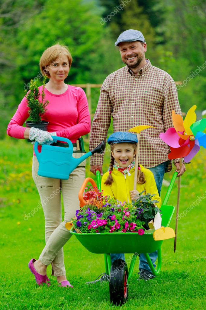 Gardening Happy Family With Wheelbarrow Working In The Garden Stock Photo Gorilla 31302077
