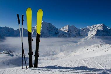 Ski, skiing, winter season , mountains and ski equipment on ski run