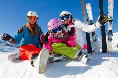Ski, winter, snow, skiers, sun and fun - family enjoying winter