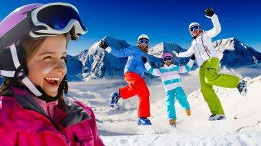 Ski, snow and winter fun - happy family ski team