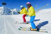 Ski, skier, snow and fun  - family enjoying winter vacations