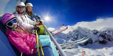 Ski lift, skiing, ski resort - happy skiers on ski lift stock vector