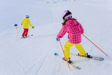 Ski, skiers on ski run - female skiers skiing downhill