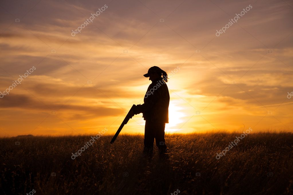 Woman Bird Hunter in Sunset