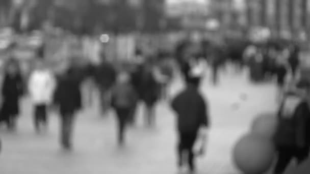 Black & white city scene with pedestrians. Time lapse