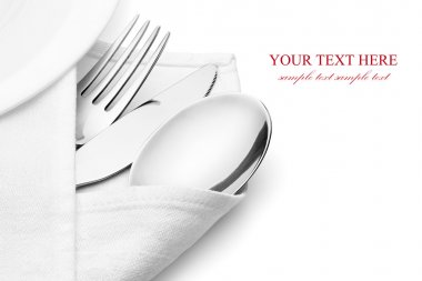 Knife, fork and spoon with linen serviette.