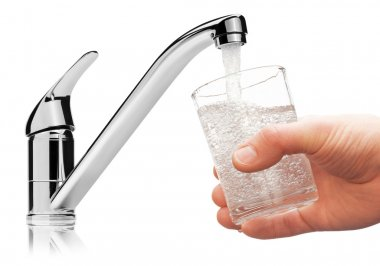 Glass filled with drinking water from tap.