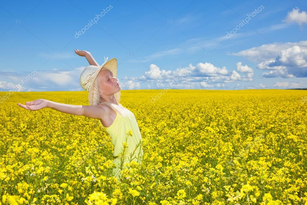 Beautiful young girl in the summer field.