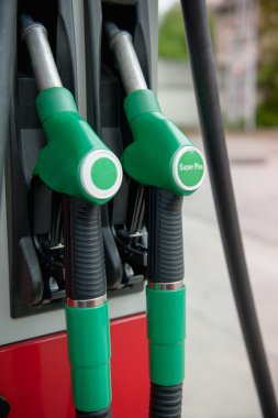 Close up of two green power gasoline pump stock vector