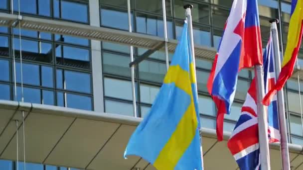 Flags of Sweden, United Kingdom, Romania,Slovakia,  Finland waving in front of Parliament, Strasbourg