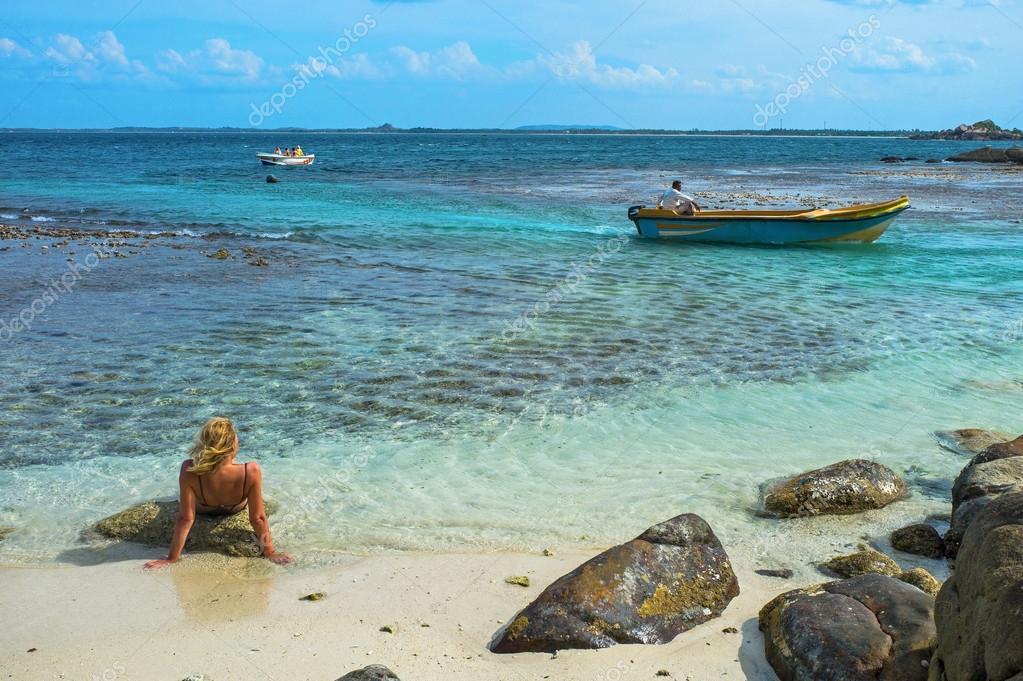 Woman sun bathing in Pigeon island