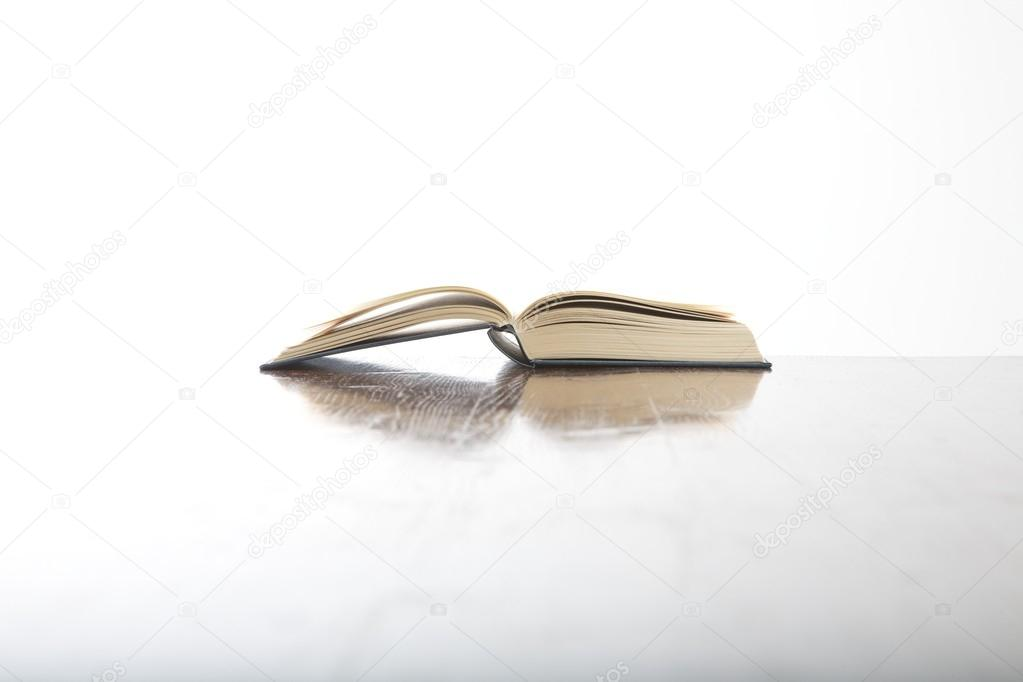 open book side on table