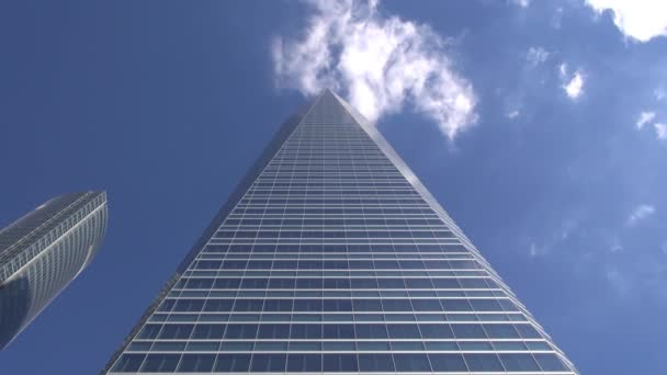 Pyramid skyscraper with clouds on top
