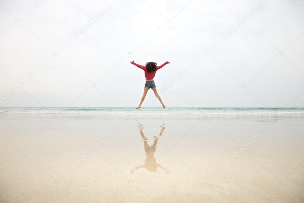 Woman jumping on mist sky