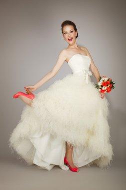 happy bride holding heel
