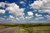 Long road with clouds