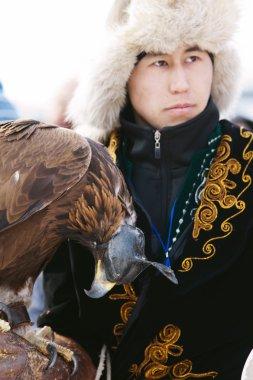 NURA, KAZAKHSTAN - FEBRUARY 23: Eagle on man's hand in Nura near