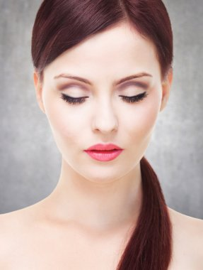 Attractive woman with perfect skin, eyes closed