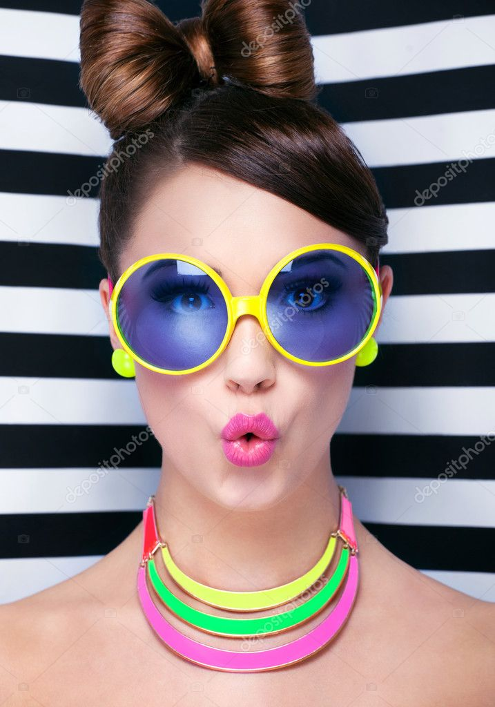 Surprised young woman wearing sunglasses