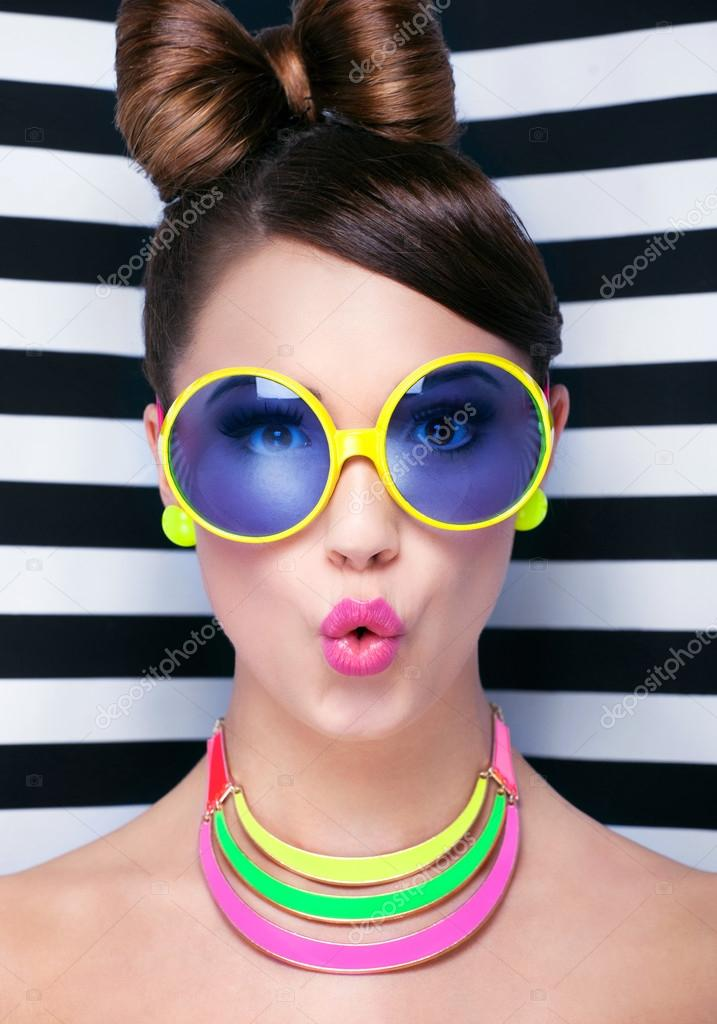 Wearing Sunglasses Pictures  surprised young woman wearing sunglasses stock photo