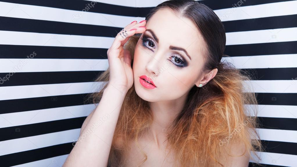 6ed62845565 Portrait of beautiful young woman with professional party make up false  eyelashes on stripy background — Photo by ...