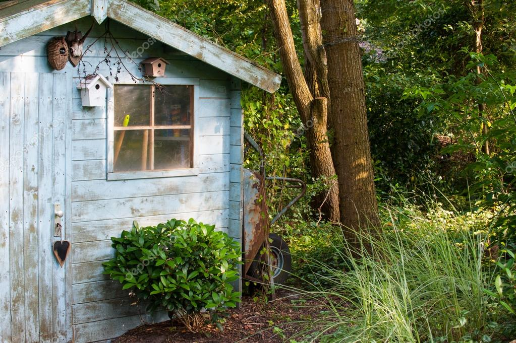 Blue old garden shed