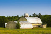 Traditional American Yellow Barn With Blue Sky