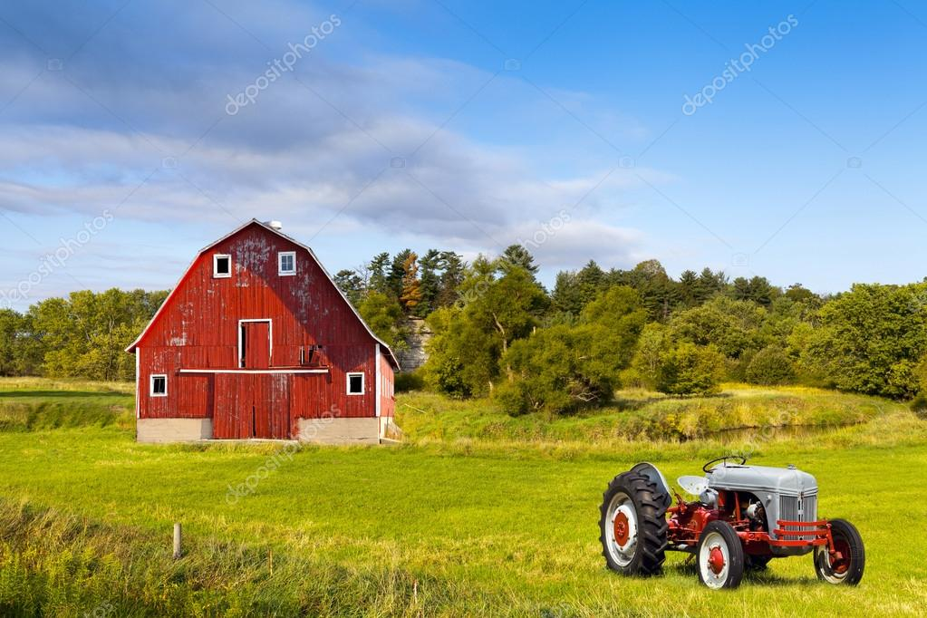 Traditional american red barn with vintage tractor stock for American barns prices