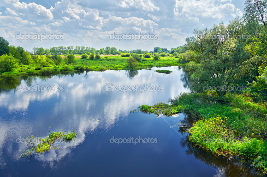 Фотообои Spring landscape with Narew river and clouds on the sky