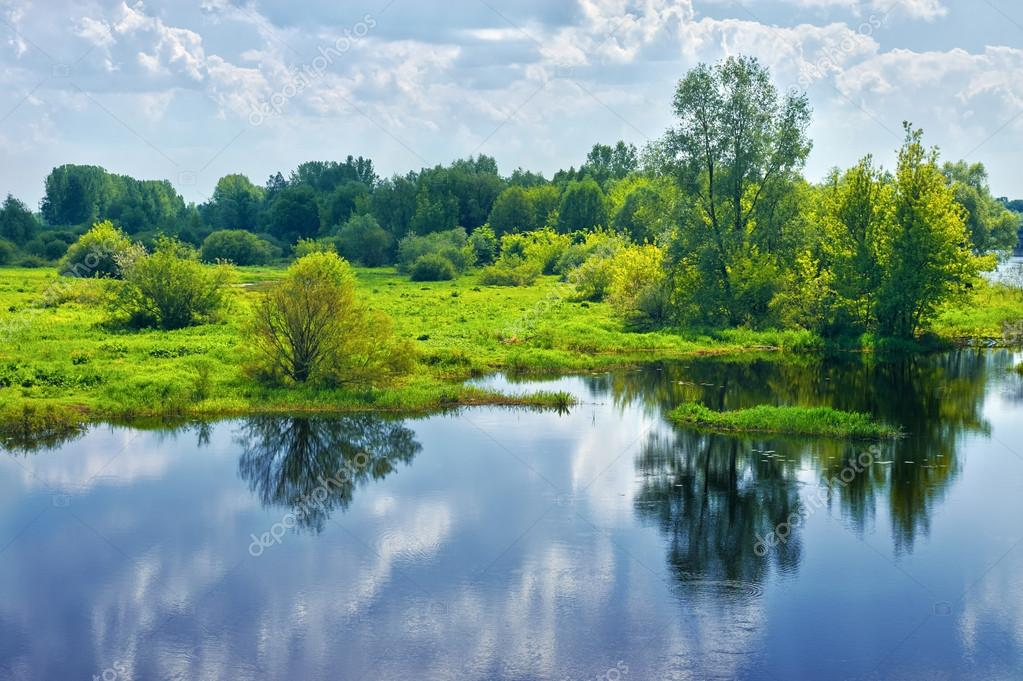 Фотообои Spring landscape with river and clouds on the sky