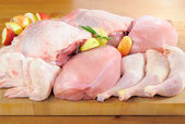 Poultry meat arrangement on kitchen board