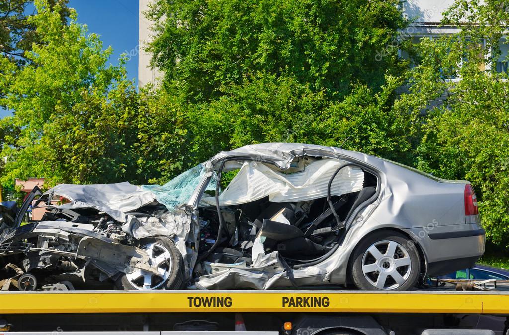 Crashed Luxury Car Parked On A Tow Truck Stock Photo C Utiwamoj