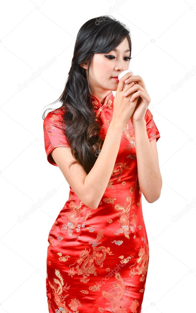 c427ef940 Pretty women with Chinese traditional dress Cheongsam and drinking tea on white  background — Photo by anankkml