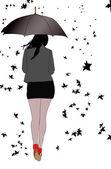 Fotografie Frau mit Regenschirm Wind und Blätter